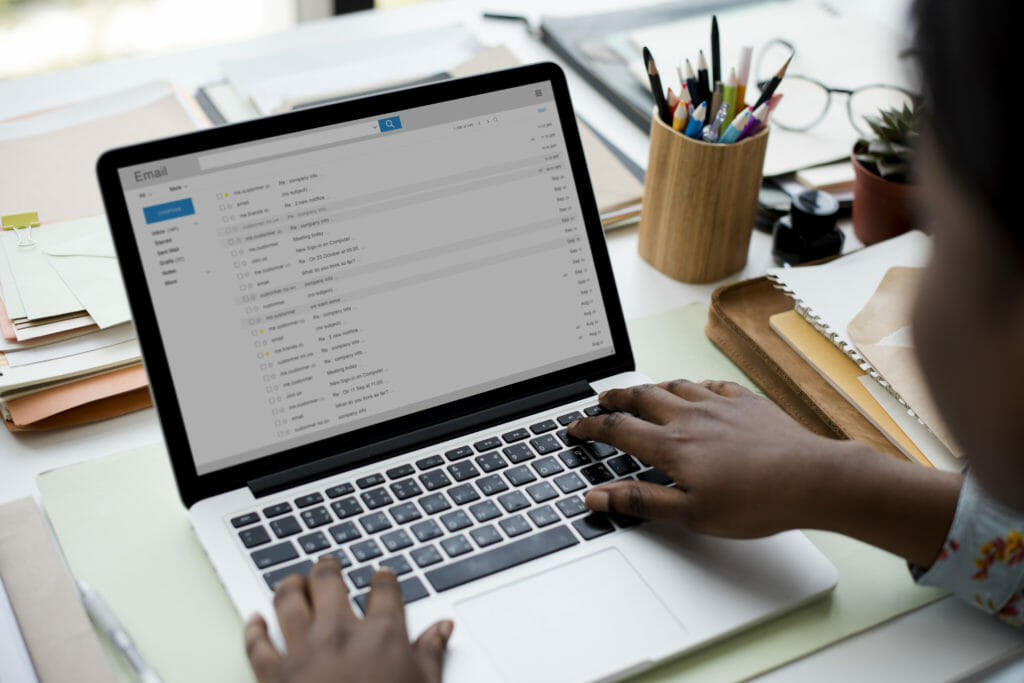 Image of man working on email marketing campaign
